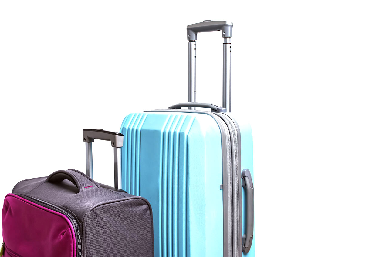 Two suitcases of pink and blue color close-up.